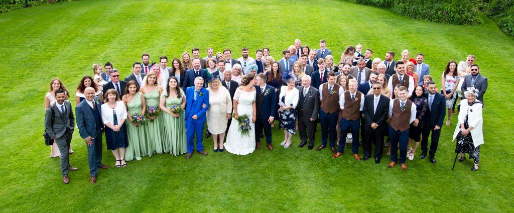 wedding guests kiss bride & groom