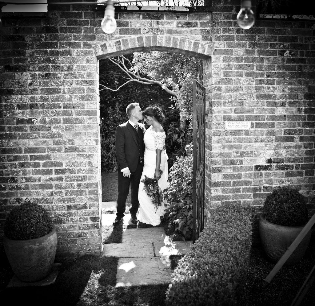 bride groom framed doorway bricks