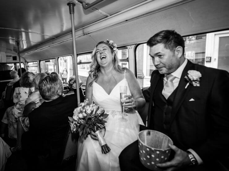 Bride and groom back on the bus to the pub!