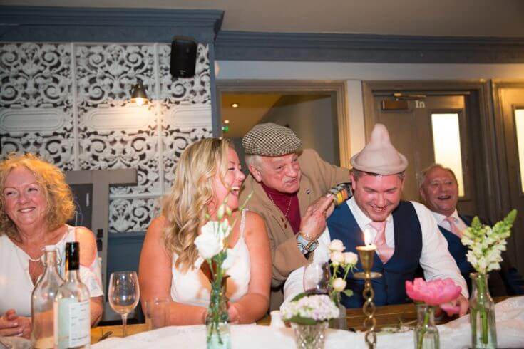Del Boy with the wedding guests at the George Belsize Park