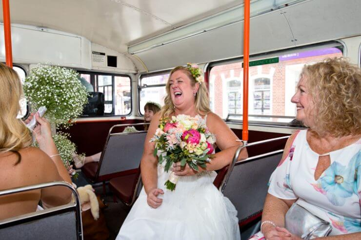 Bride on the bus on her way to getting married.