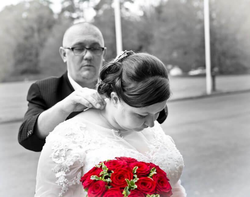 bride brother venue red roses wedding dress