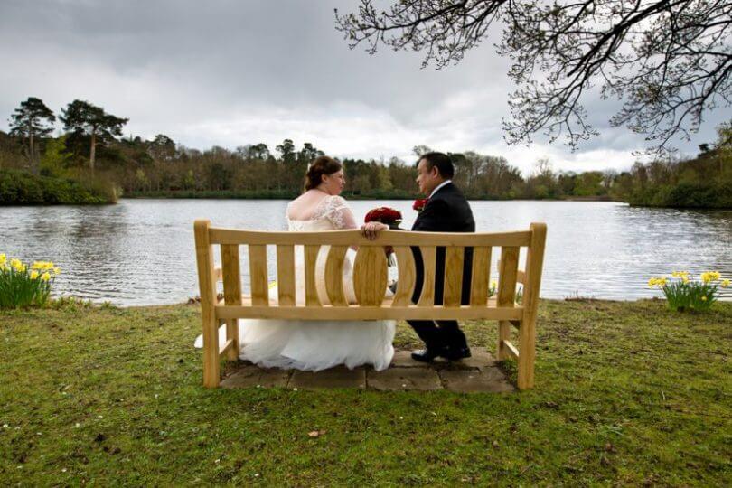 lake bench bride groom sit relax smile