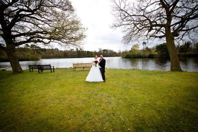 lake pond bride groom wedding dress