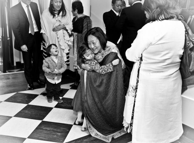 groom's mother greets guest wedding Izabela Amreet