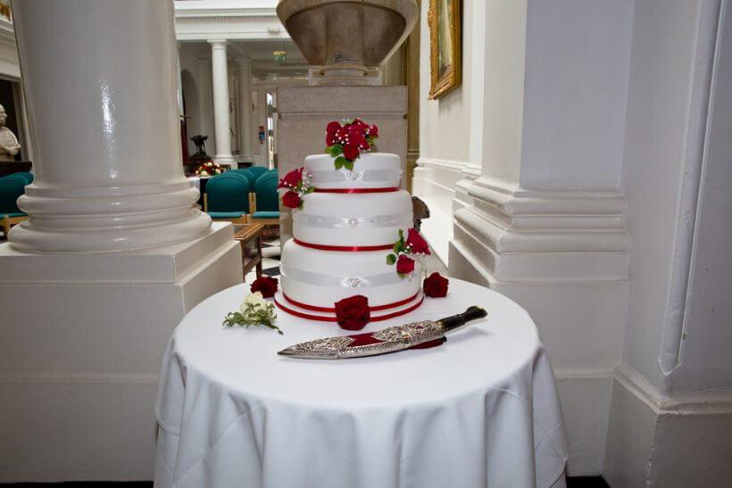 wedding cake bride groom knife roses flowers tear