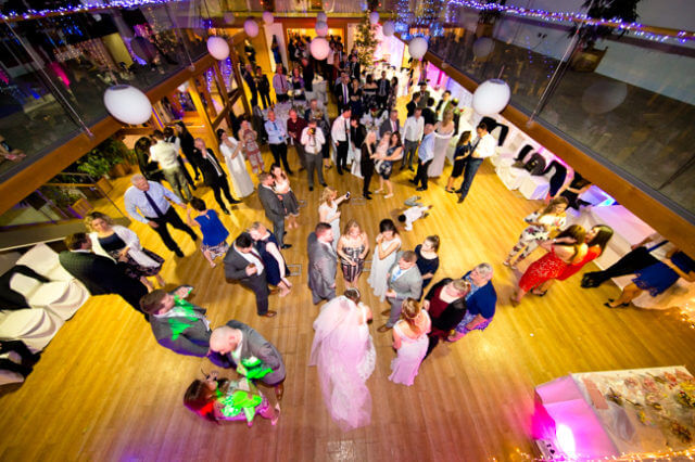 wedding guests dance bride