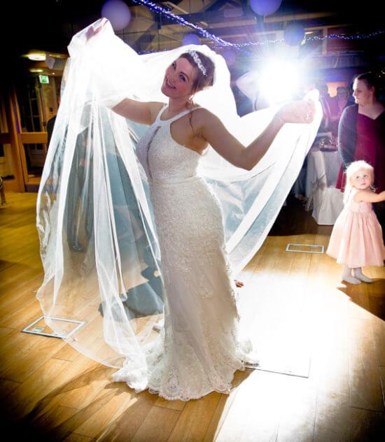 bride dance floor dancing light bright white dress