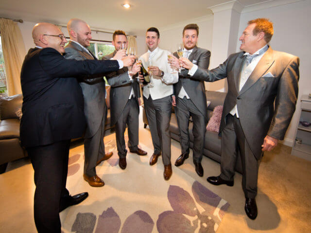 groom brother champagne drink toasting