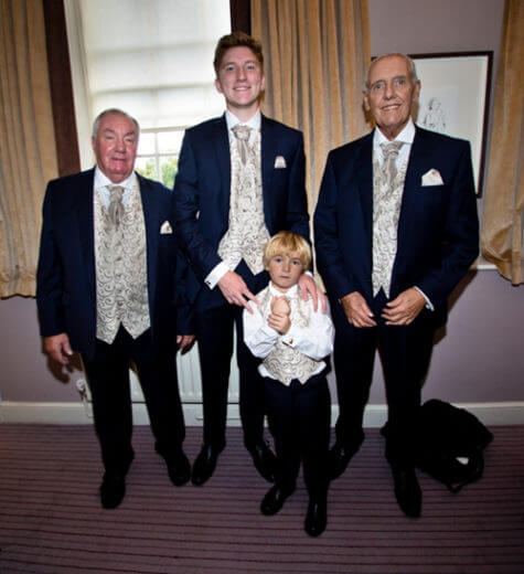 Ray best man groom son sons step hotel room smile