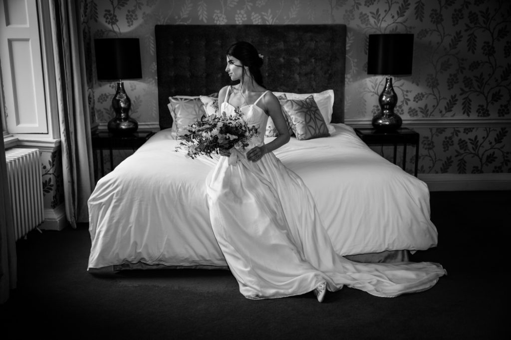 bride wedding suite room dress bouquet flowers