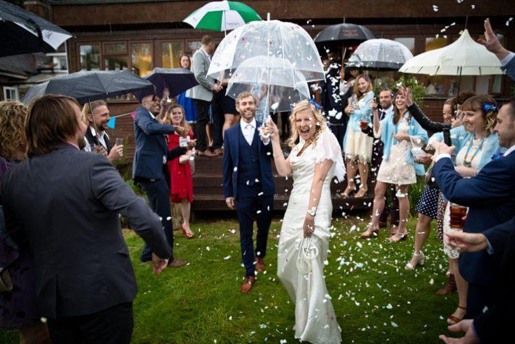 confetti wet rain bride groom happy laughing