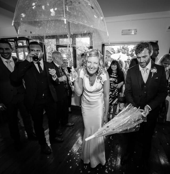 umbrella bride groom