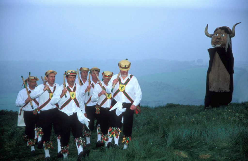 Wessex Morris Men dancing on top of the hill at  Cerne Abb
