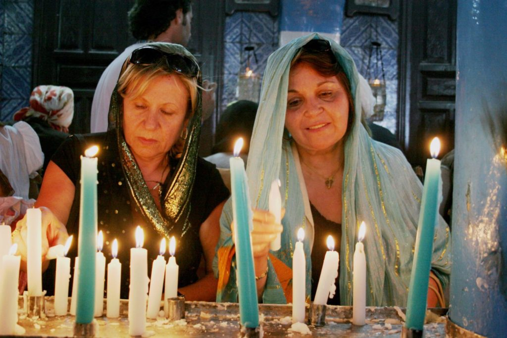 Pilgrims lighting candles El Ghriba Synagogue Djerba Tunisia