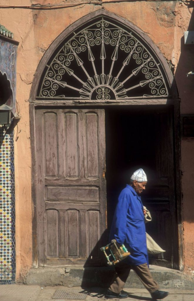 Man-walking-pass-in-the-old-Medina-in-Fes-el-bali-Morocco-Morocco-copy-697x1080