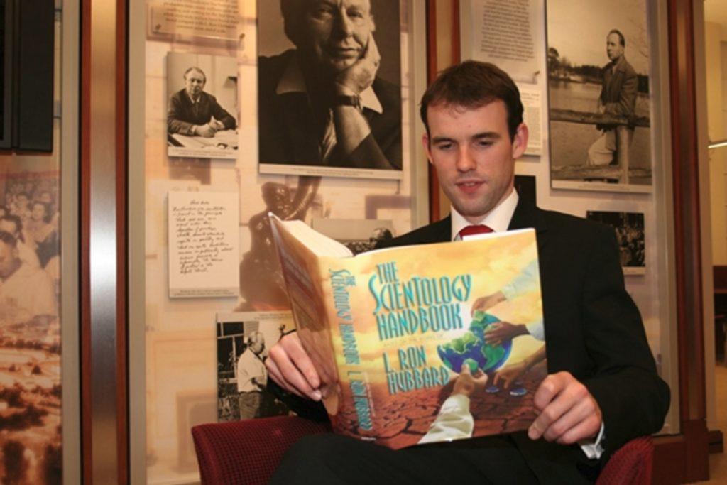 Scientologist_reading_handbook_London