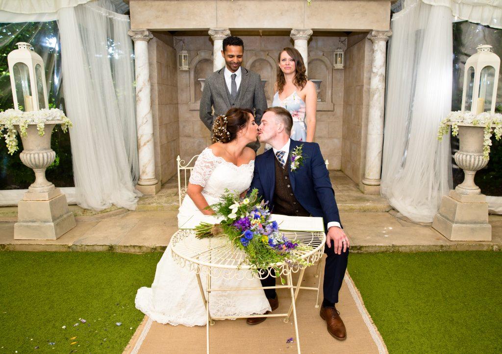 bride groom kiss wedding ceremony book
