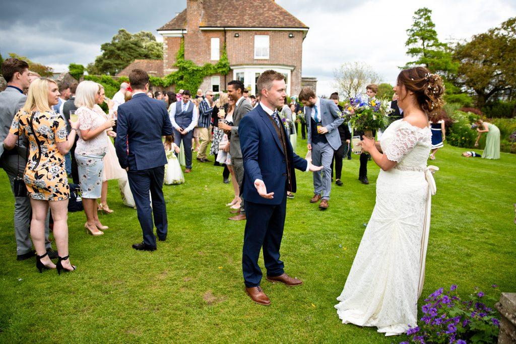 groom bride welcome arms open
