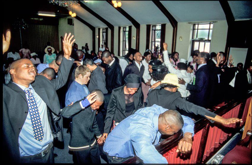 Preacher invites congregation to accept church God Holy Spirit.