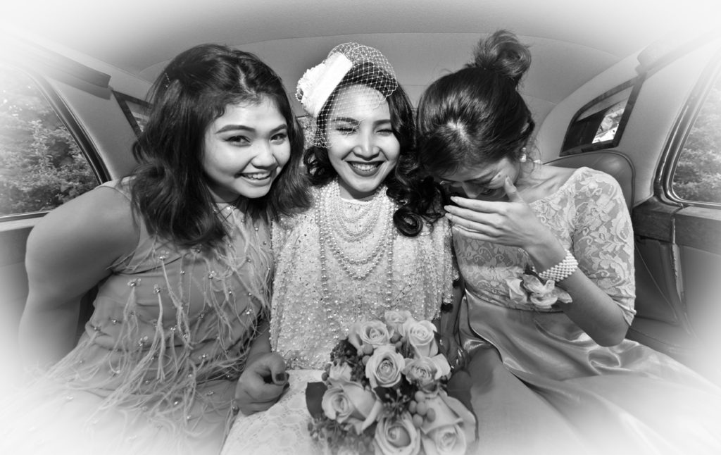 Bii in the car with her bridesmaids.