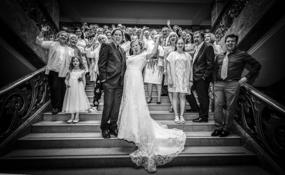 Bride & Groom celebrate on the steps of Wandsworth Town Hall with their guests