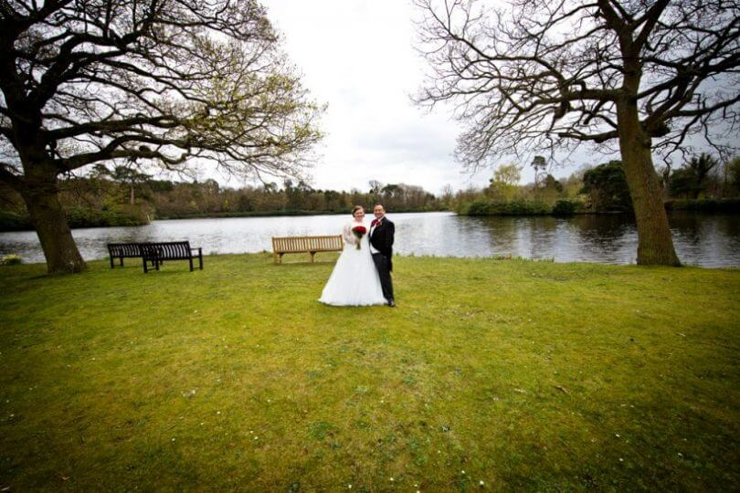 lake pond bride groom wedding dress