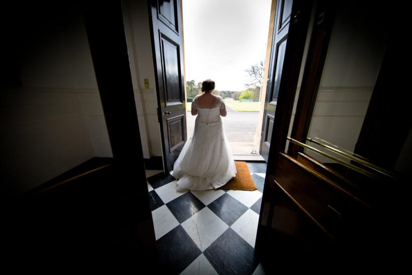 bride contemplating after her wedding front door venue (c) gapper