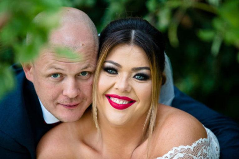 bride groom park newlyweds smile