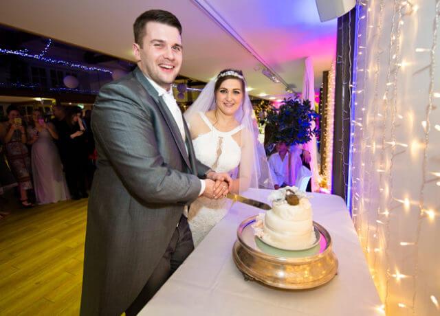 wedding cake cut cutting bride groom