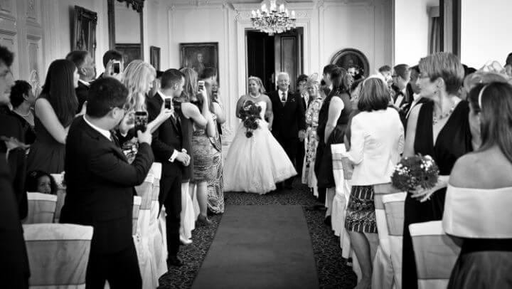 bride father arrive walk aisle