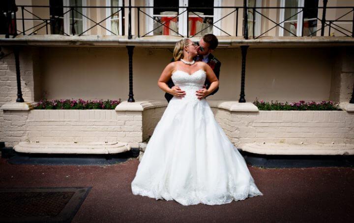 bride groom kiss cuddle