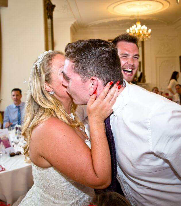 kiss bride and groom wedding breakfast