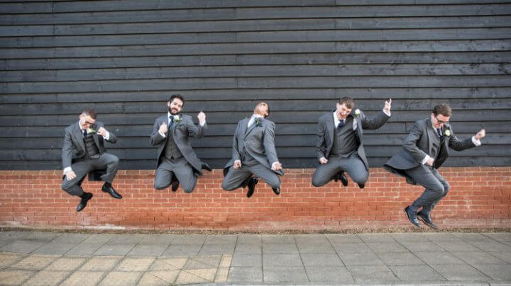 Groom & groomsmen air guitar
