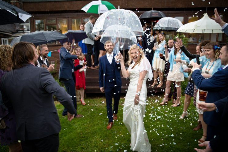 confetti wet rain bride groom happy laughing