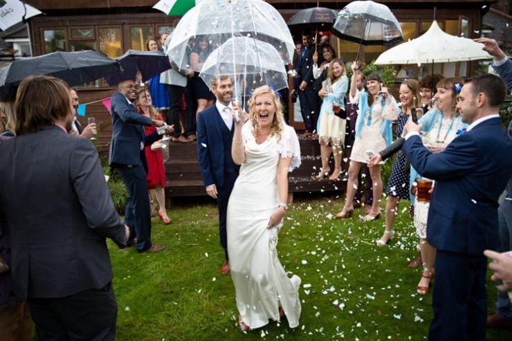 bride groom umbrella rain