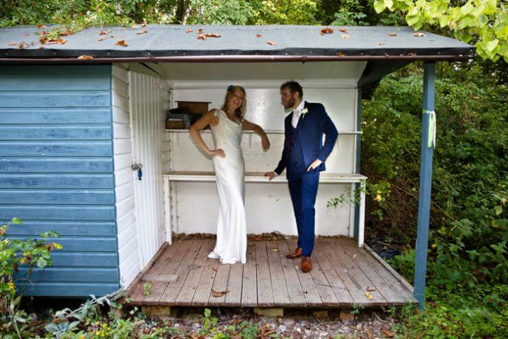 bride groom pose shed garden
